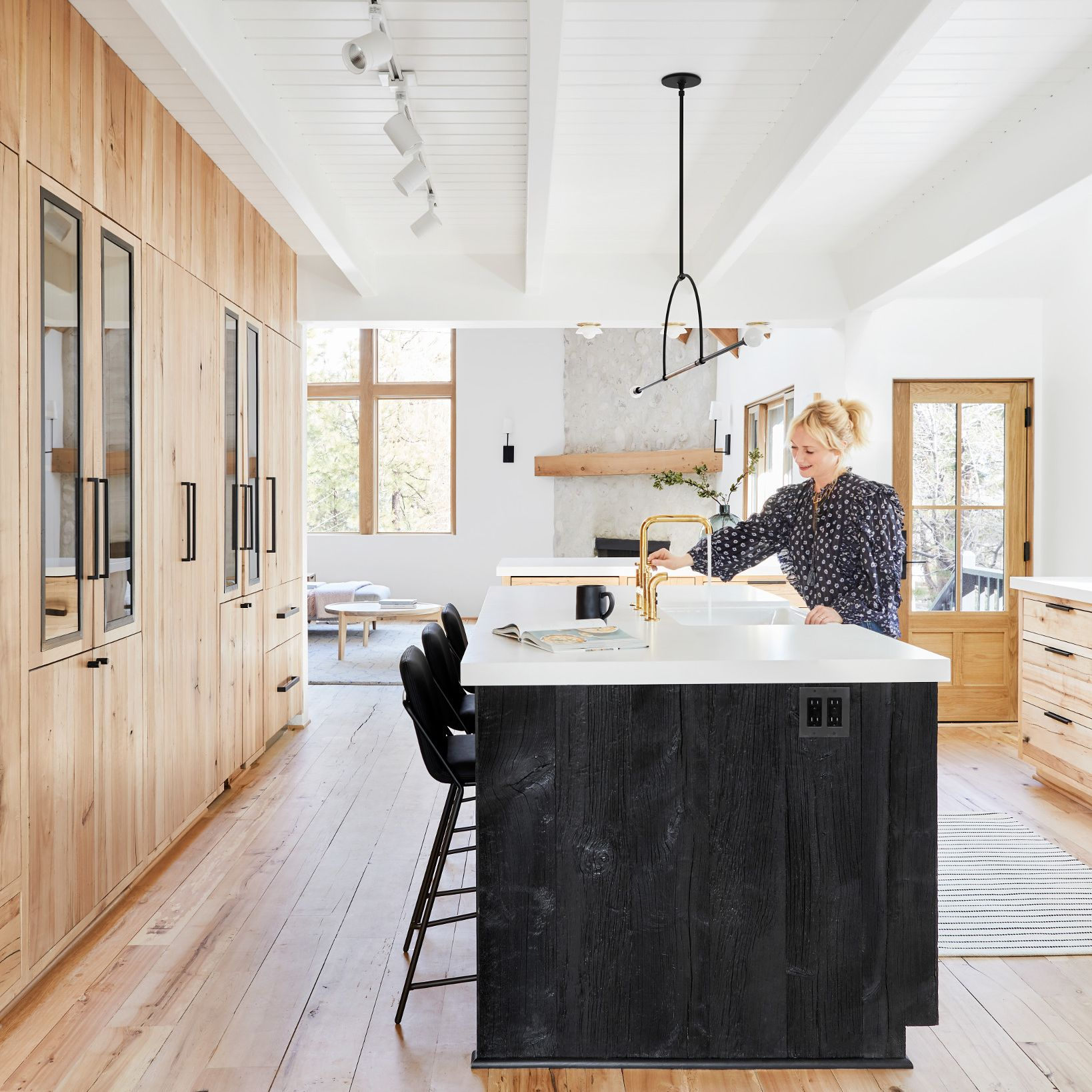 A kitchen with a wood floor  Description automatically generated