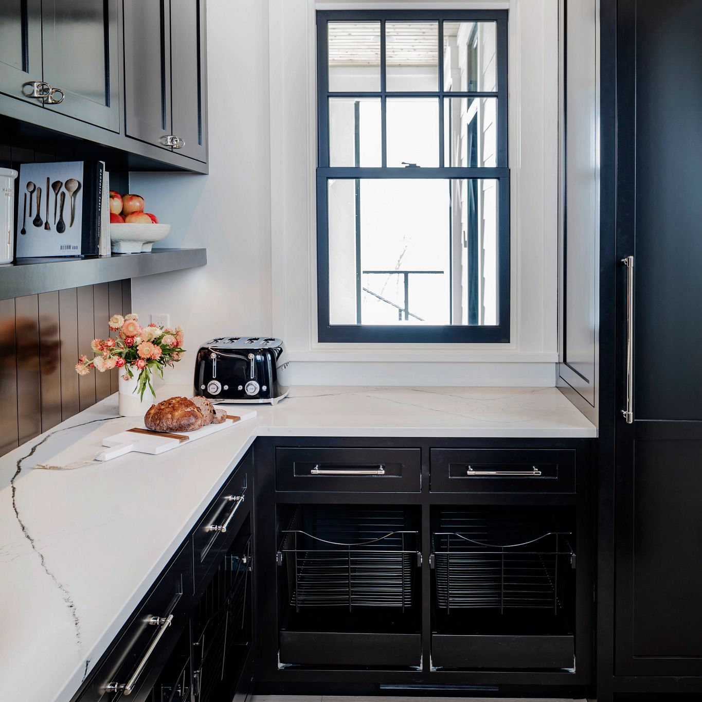 A kitchen with black cabinets  Description automatically generated with low confidence
