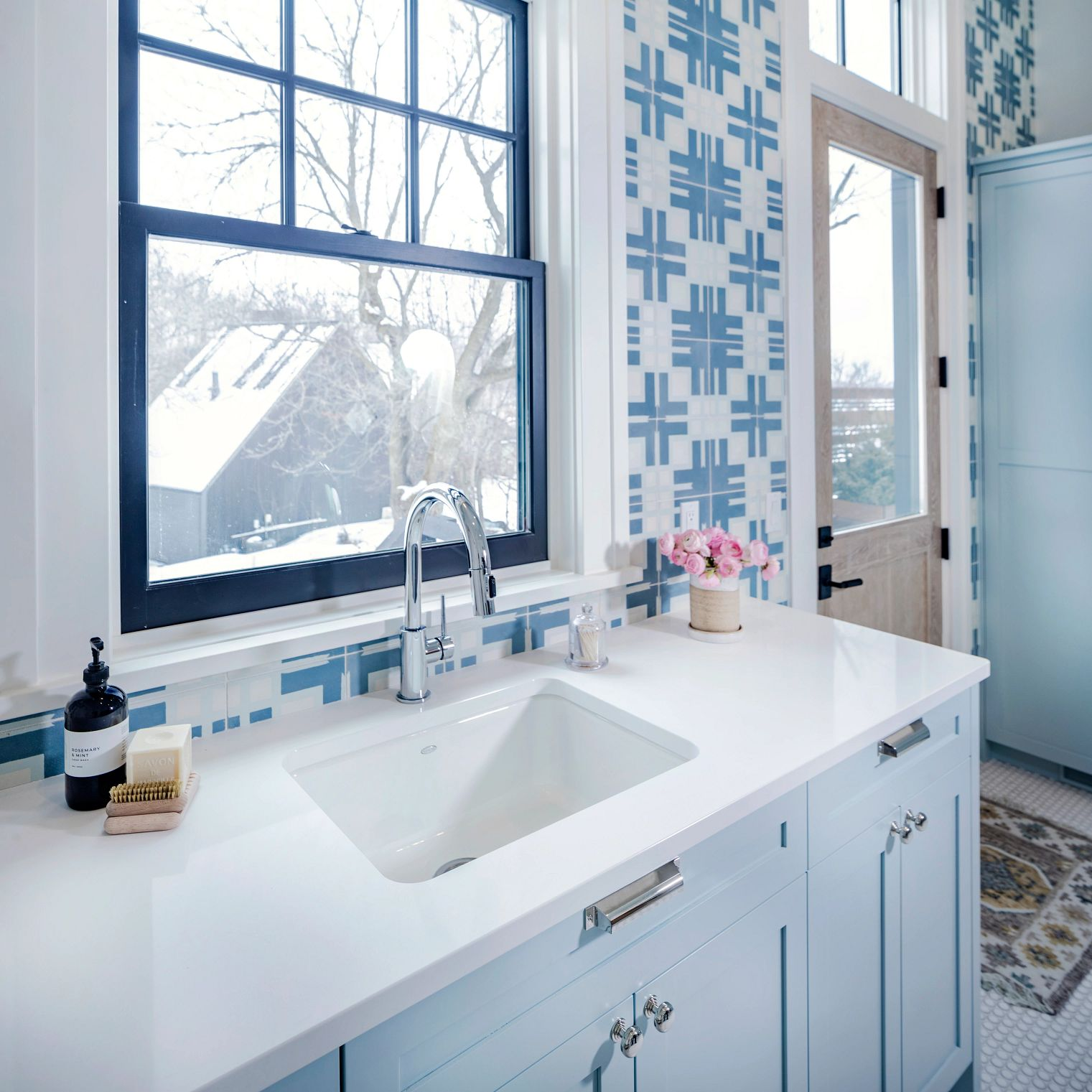 A bathroom with a sink and a window  Description automatically generated with low confidence