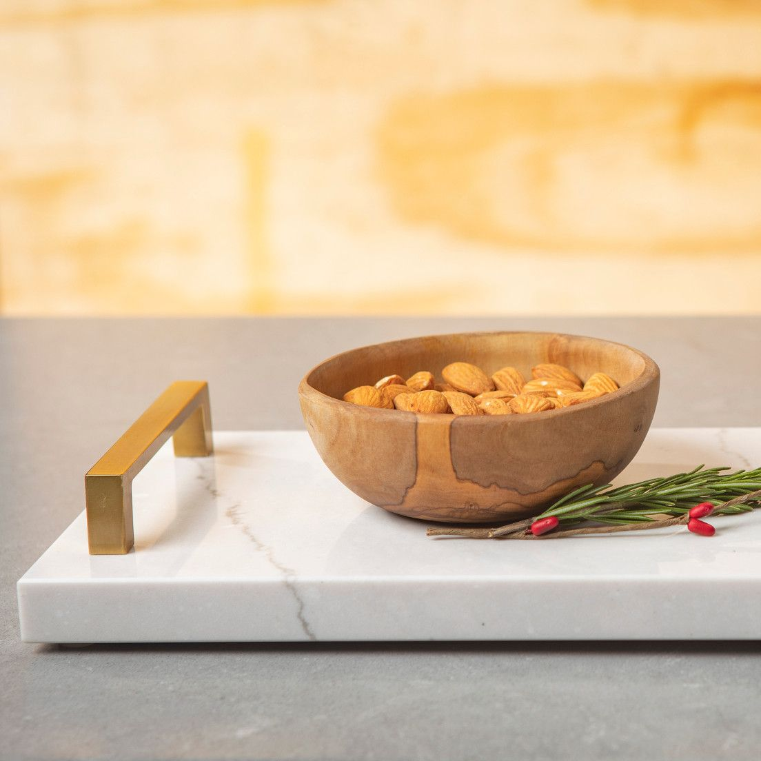Cambria tray with handles with almonds in a wooden bowl on top.
