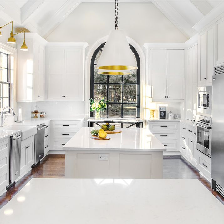 A kitchen with white cabinets  Description automatically generated with low confidence